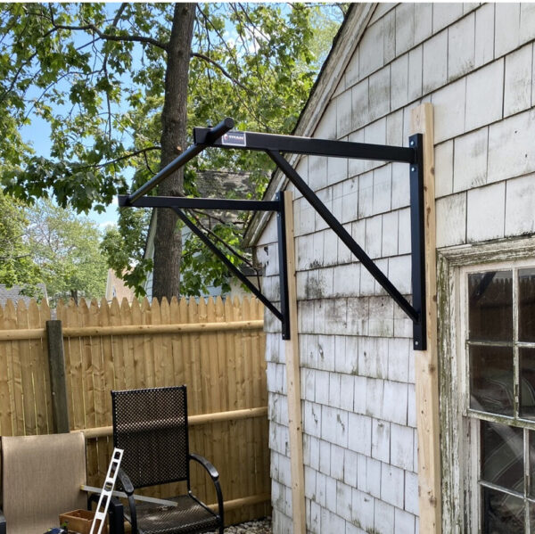 WALL-MOUNTED PULL-UP BAR in courtyard