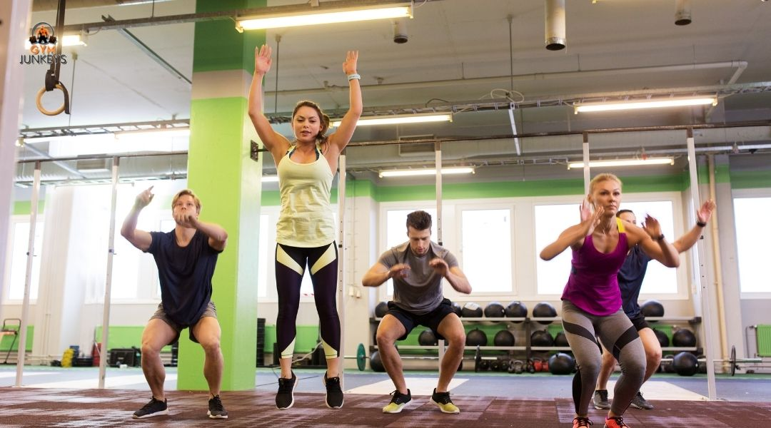 Group of people doing burpees to become more explosive
