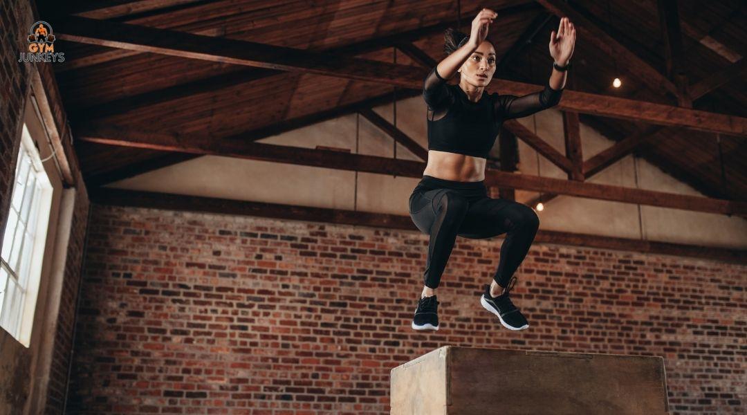 woman jumping up onto a box