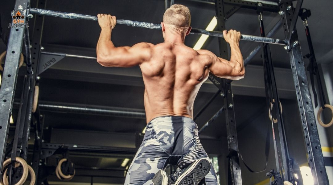 man doing a pull up to become more explosive