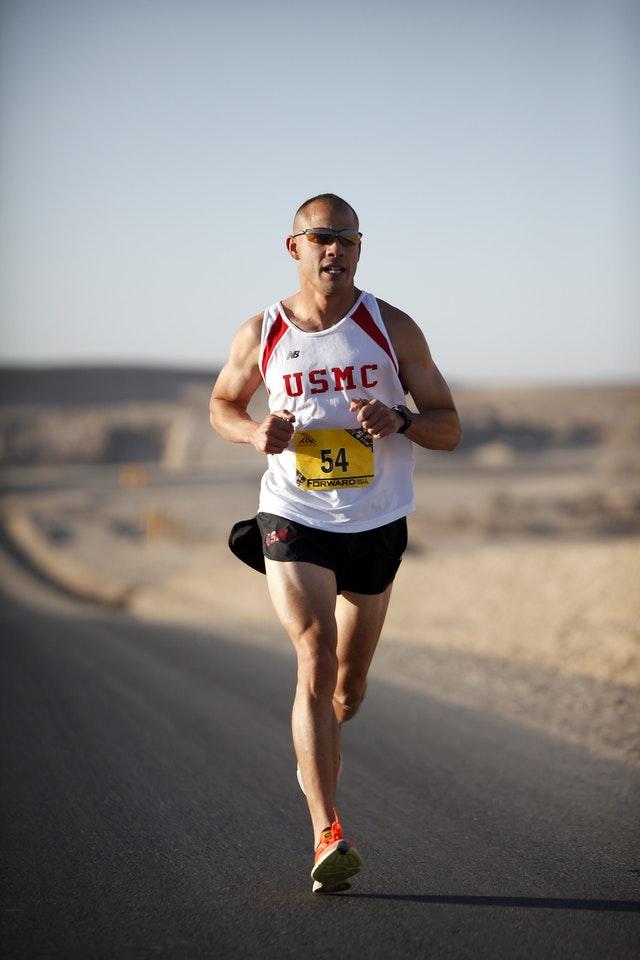 Determined man running in marathon