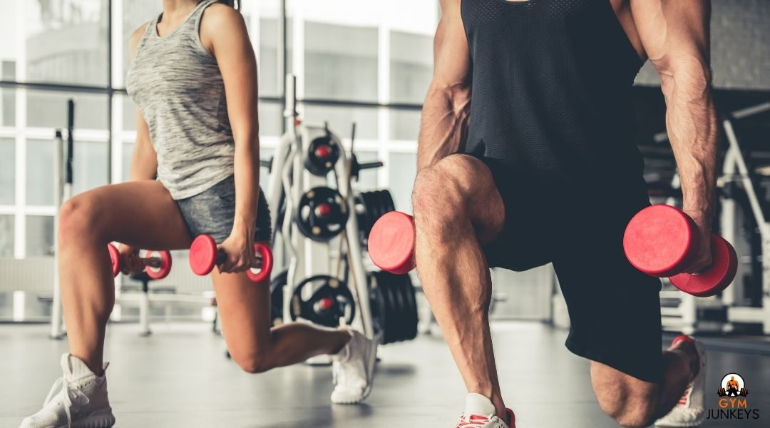woman and man lifting weights in a gym.